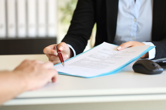 Signing a vacation rental agreement