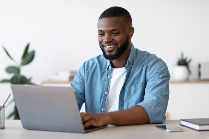 Man checking his Booking.com fees for the month